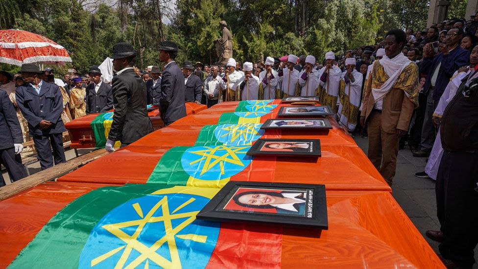 Coffins representing Ethiopian passengers and crew who perished in the Ethiopian Airways ET302 crash are lined up during a memorial service at Selassie Church on March 17, 2019 in Addis Ababa, Ethiopia.
