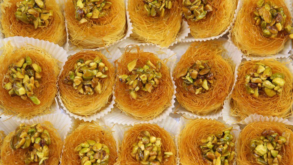 Pastries topped with pistachios