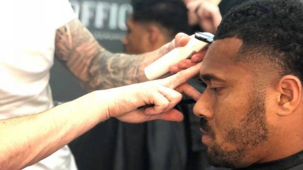 Australian winger Sefa Naivalu getting his hair cut