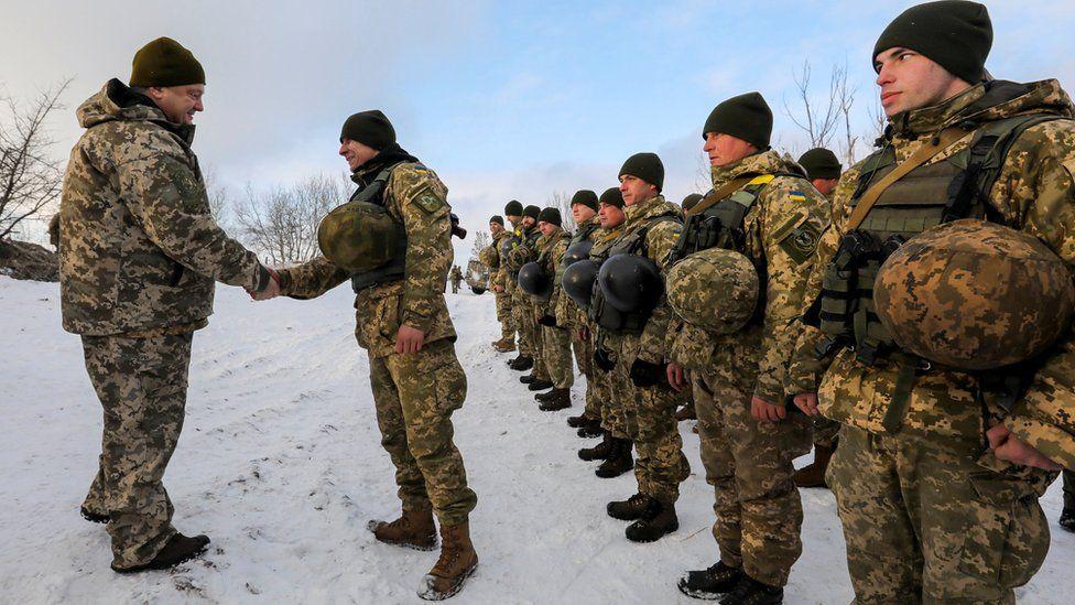 President Poroshenko (left) meets Ukrainian troops near rebel-held Horlivka, 5 Dec 16