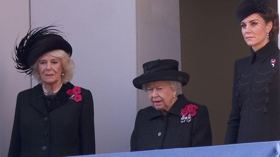 The Queen watching from a balcony