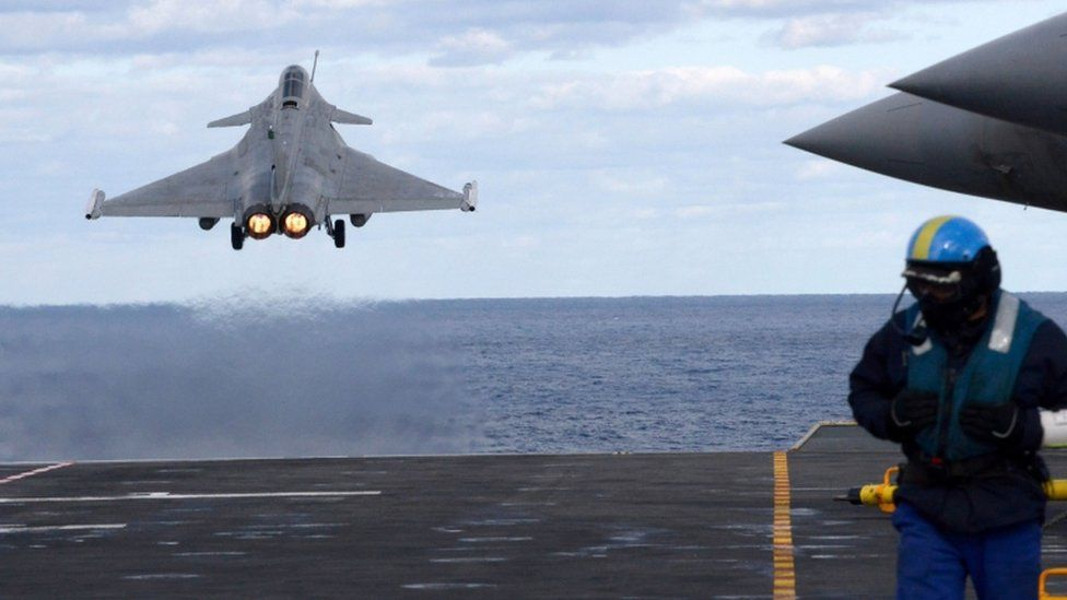 A French fighter takes off from the aircraft carrier Charles de Gaulle in the Mediterranean