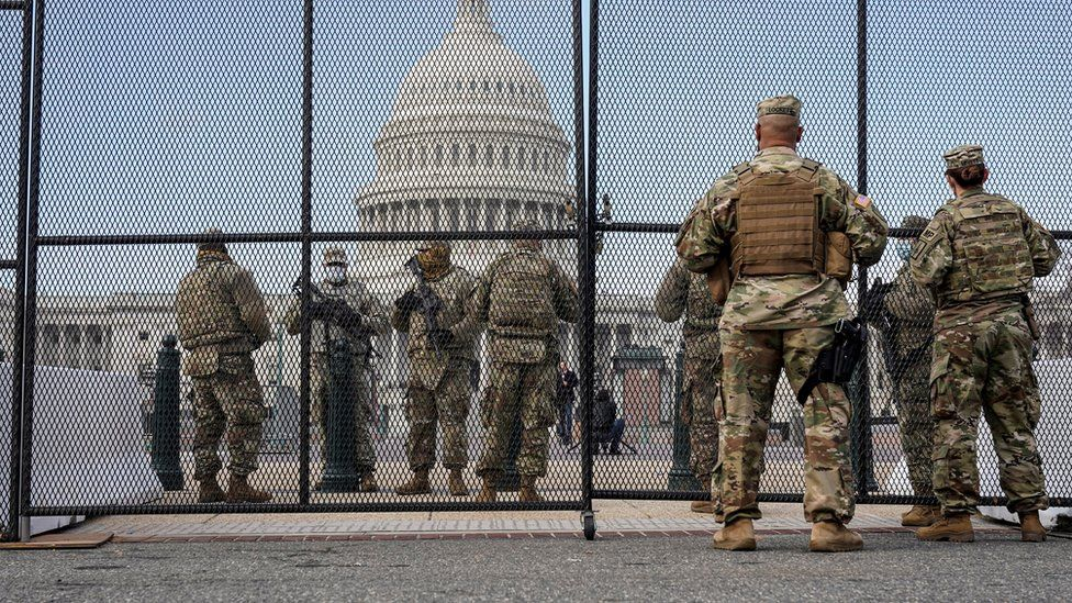 National Guard soldiers maintain a watch over the U.S. Capitol after the House of Representatives impeached U.S. President Donald Trump in Washington,