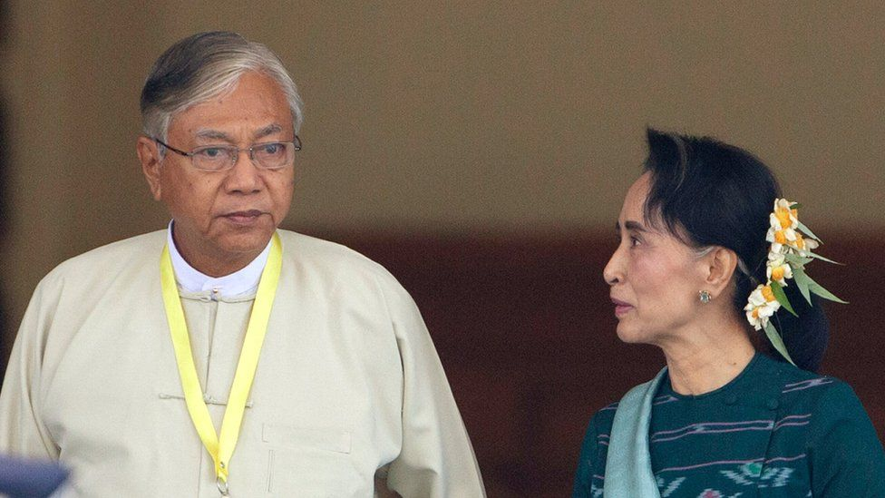 Htin Kyaw, left, newly elected president of Myanmar, walks with National League for Democracy leader Aung San Suu Kyi, right