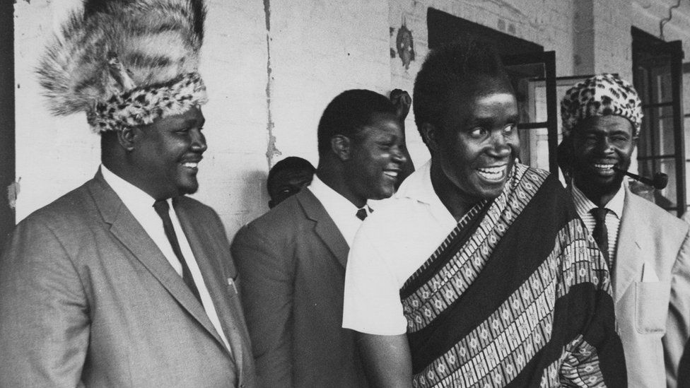 Kenneth Kaunda, leader of the Northern Rhodesian African Nation Congress, and Joshua Nkomo (left), leader of the banned Zapu (Zimbabwe African People's Union) party of Southern Rhodesia, attend the ceremony for the swearing-in of Dr Hastings Banda as the first prime minister of Nyasaland (later Malawi), in the legislative assembly at Zomba, January 1963