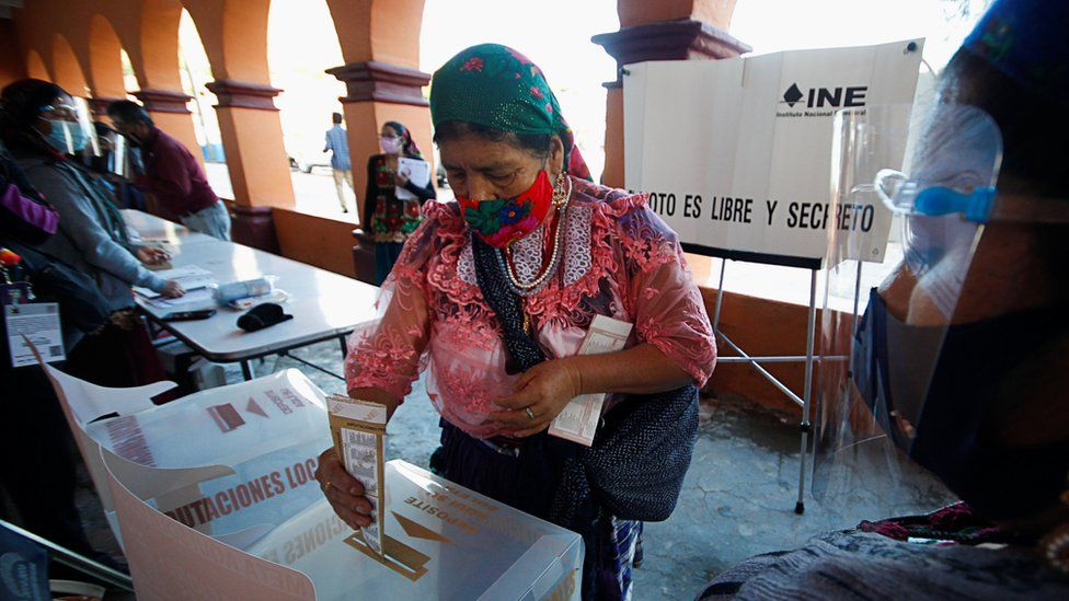 An indigenous Zapotec woman casts her vote at a polling station during the mid-term elections in the rural village of San Bartolome Quialana