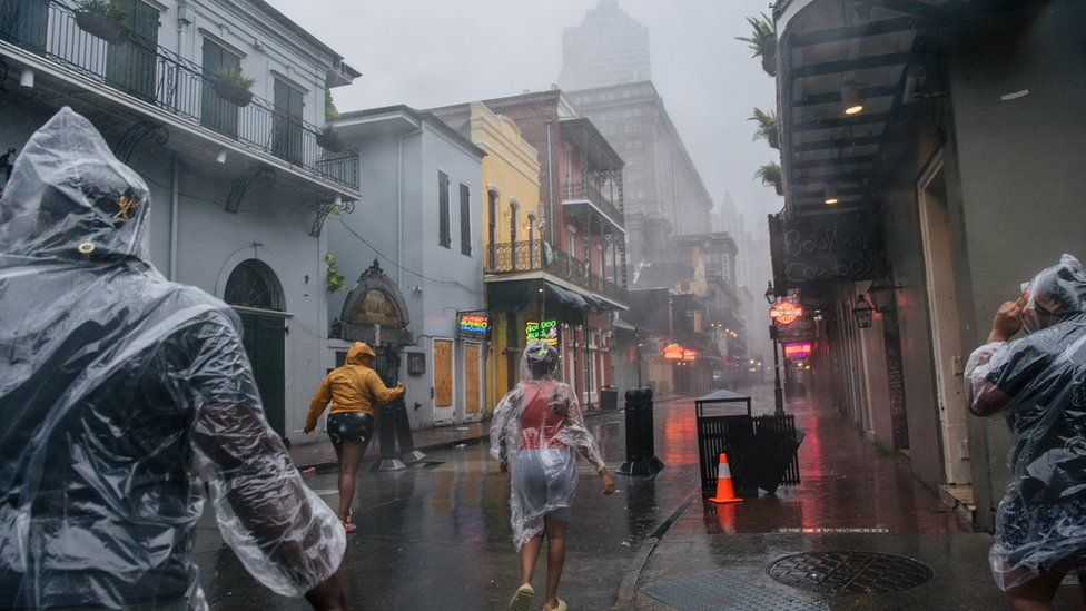 People walk through the French Quarter in New Orleans on Sunday