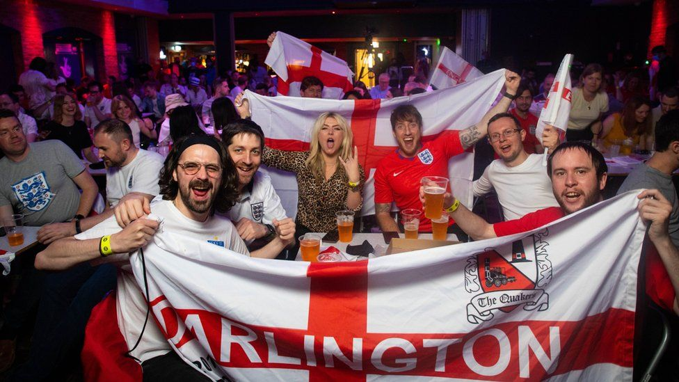 Football fans watch David Baddiel, Frank Skinner and Lighting Seeds performing their song Three Lions