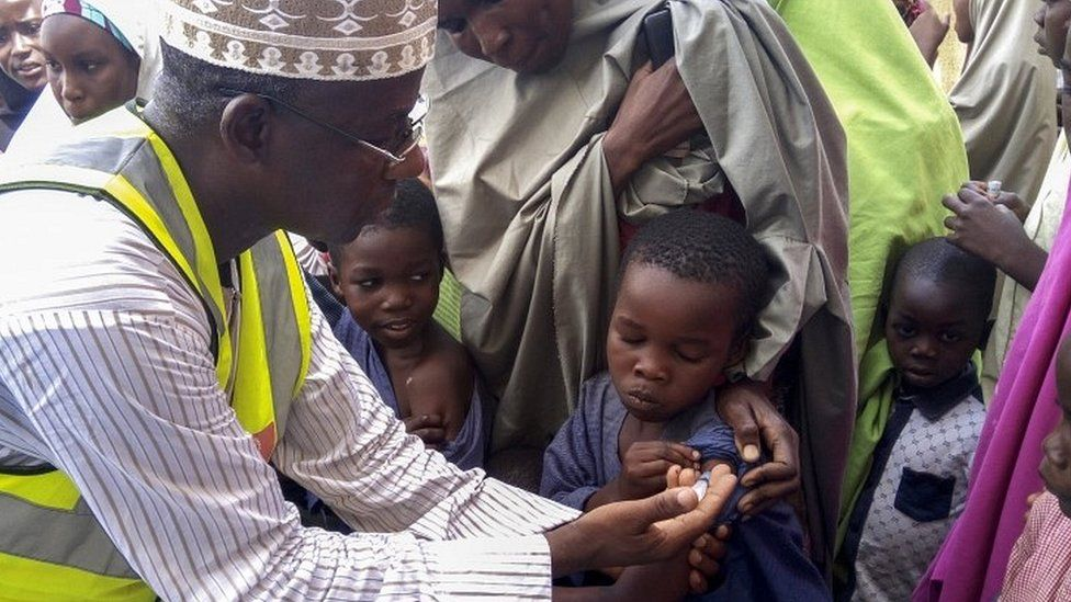 Nigerian Doctor Rilwanu Mohammed (L) Executive Secretary of the Federal capital Primary Health Care Development Board vaccinates a resident for Meningitis in Dakwa village, Bwari, Nigeria, 04 April 2017