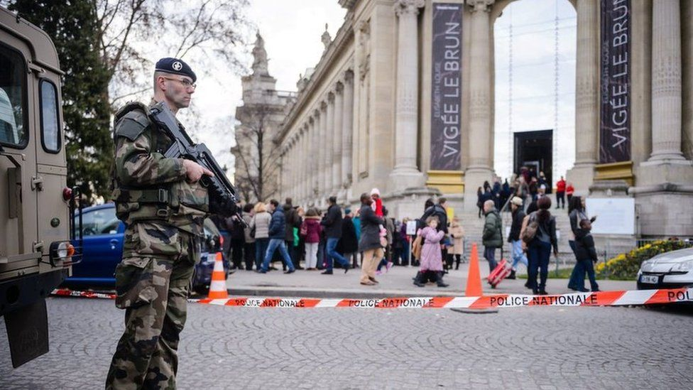 French soldiers patrol on the Avenue des Champs-Elysees in Paris
