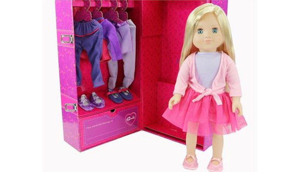 New Sindy doll in front of a wardrobe