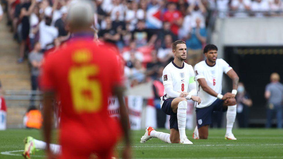 Jordan Henderson and Tyrone Mings taking a knee before England v Andorra