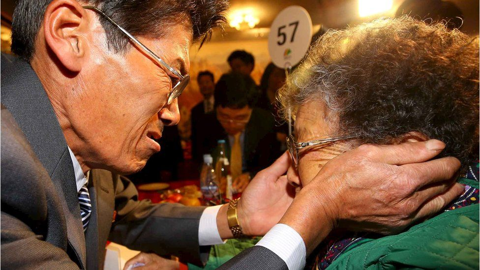 Jung Kun Mok (L) reacts as he meets his mother Lee Bok Sun during the separated family reunions at Mount Kumgang resort, North Korea, October 24, 2015