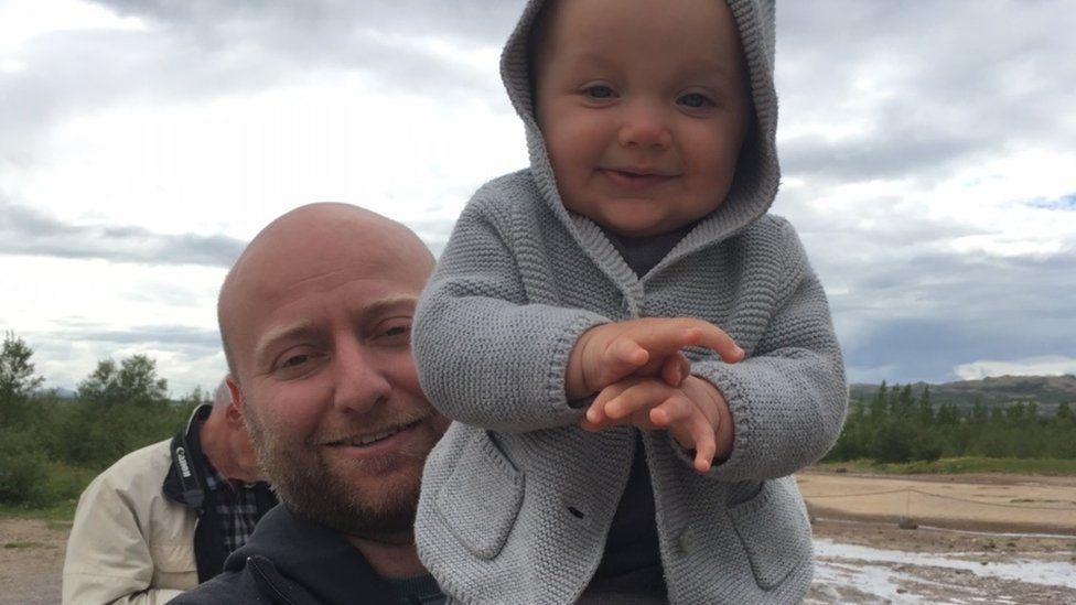 Harry Bilaver holding his son Junior
