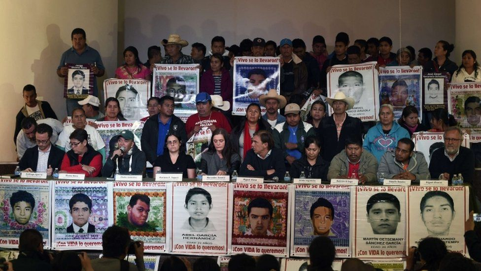 Relatives of the 43 missing students and members of the Argentine Team of Forensic Anthropology (EAAF) give a press conference in Mexico City