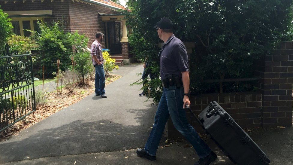 Australian Federal Police officers search the home of probable creator of cryptocurrency bitcoin Craig Steven Wright in Sydney's north shore