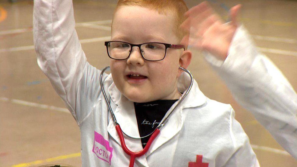 Boy dressed as nurse