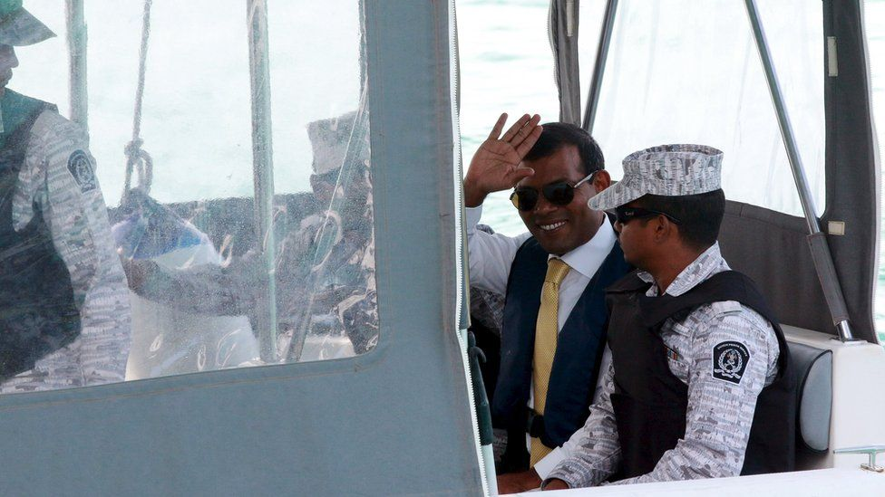 Former Maldives president Mohamed Nasheed (2nd R) waves as he is taken back to Maafushi Prison after attending Hight Court in Male City, Maldives September 9, 2015.