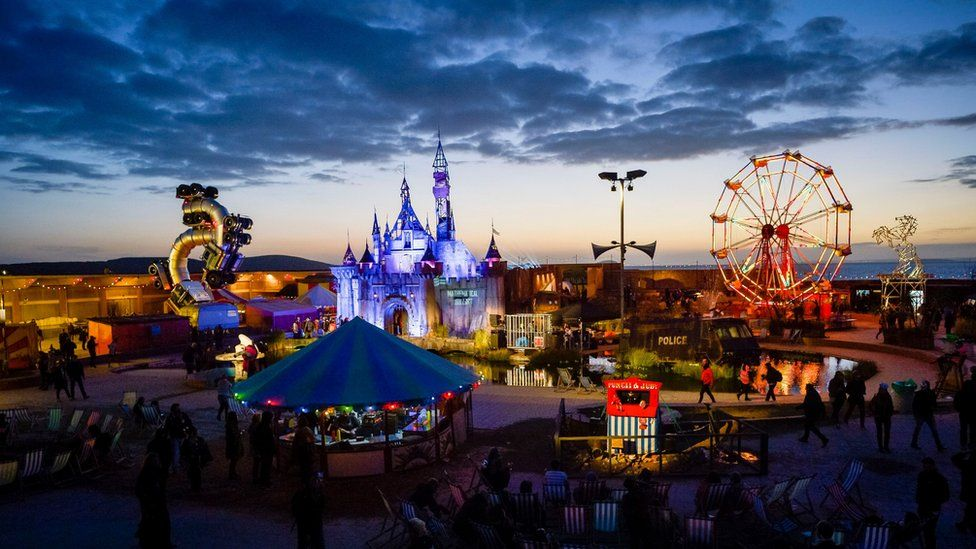 Banksy's Dismaland after sunset