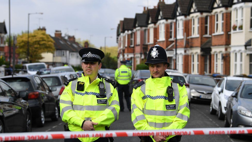 Police at the scene of the cordon over Harlesden Road