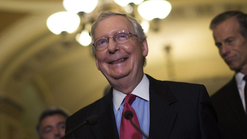 Mitch McConnell smiles at a Capitol Hill event.