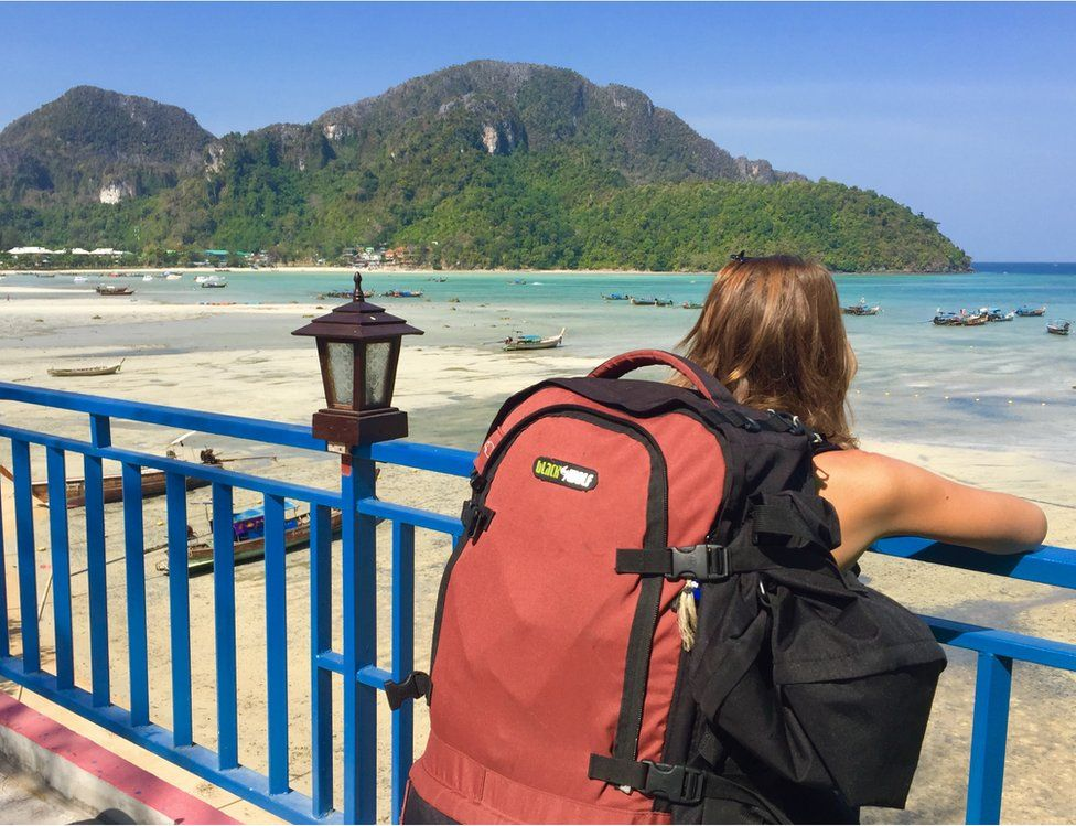 A woman wearing a backpack in Thailand