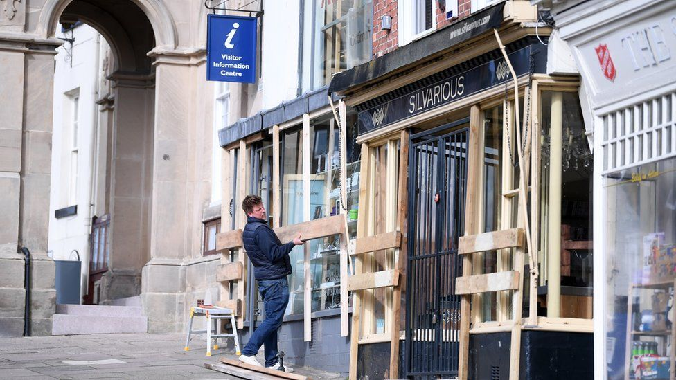 Boarding up shops ahead of Shrove Tuesday Football in Ashbourne