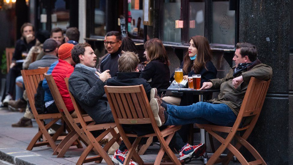 Photo dated 17 October 2020 of drinkers outside a pub in Soho, London, on the first day after the city was put into Tier 2 restrictions.