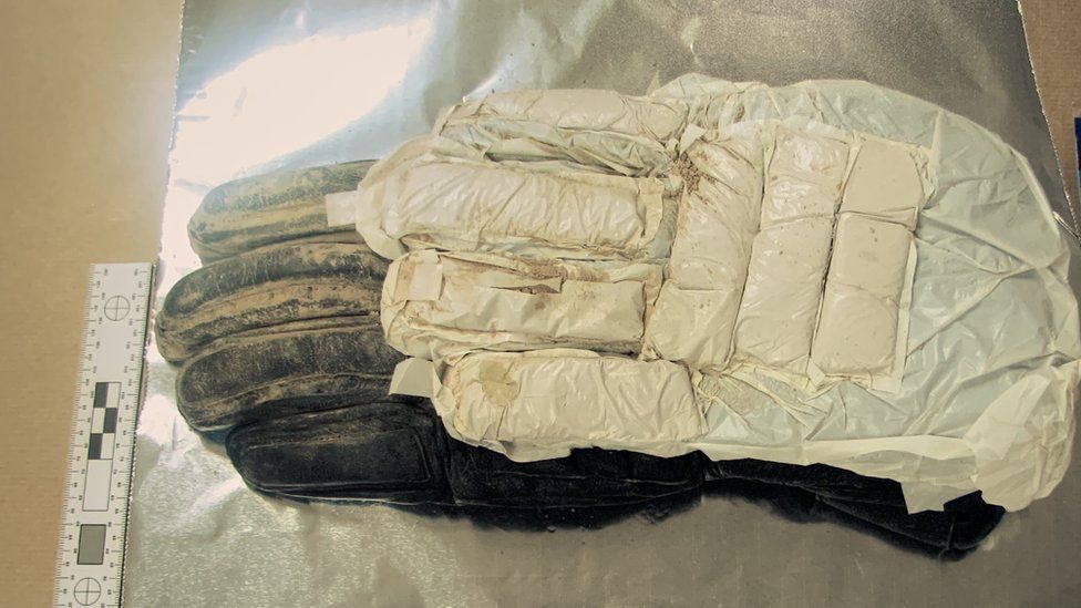 Glove with concealed drugs