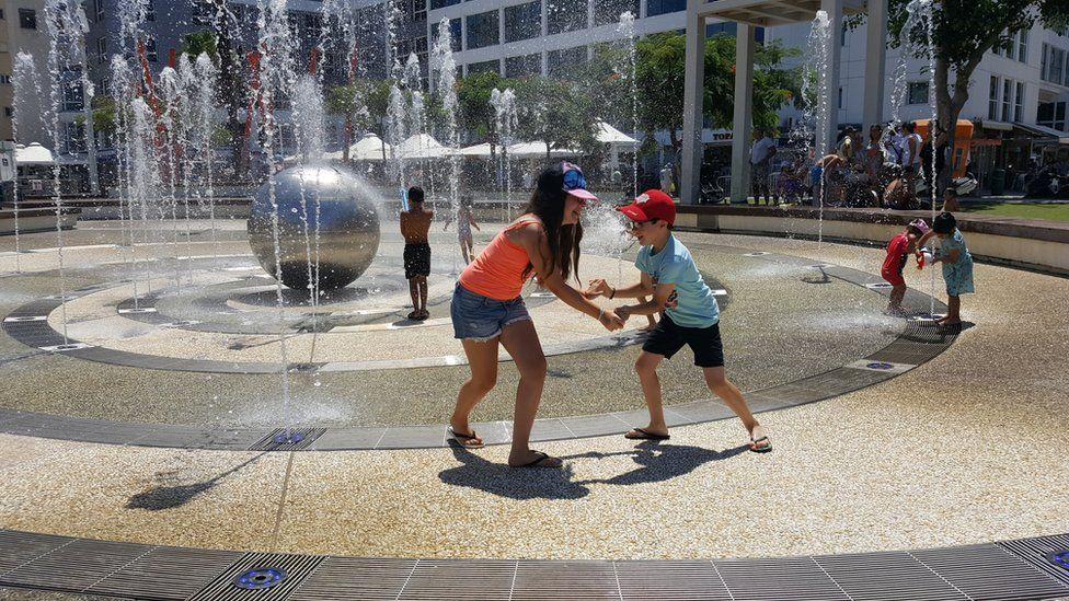 Children play in water feature in Netanya. Israel (file photo)
