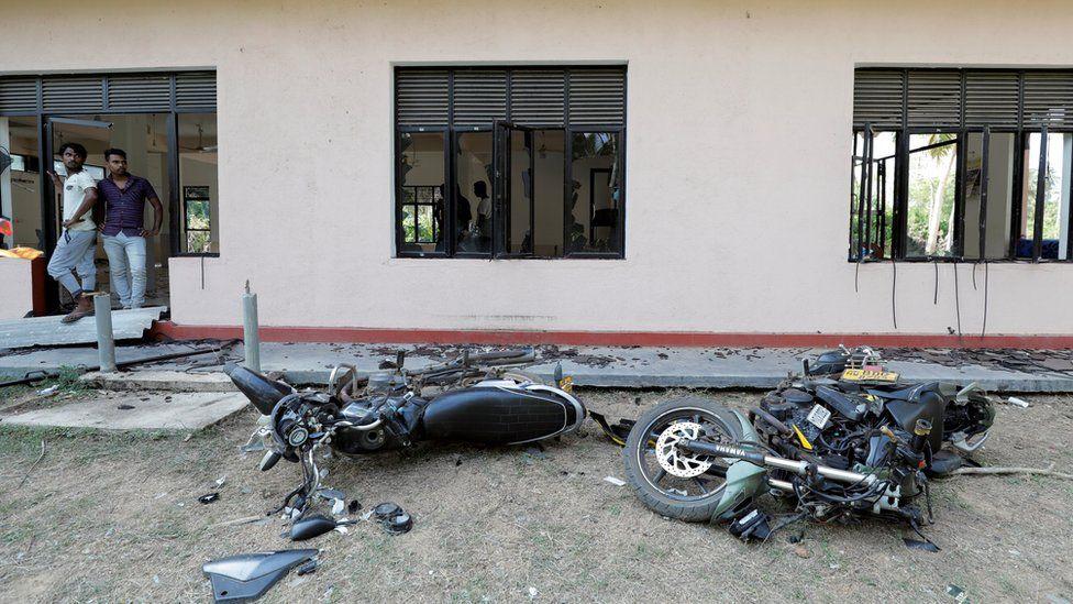Muslim men react after an attack in Kiniyama