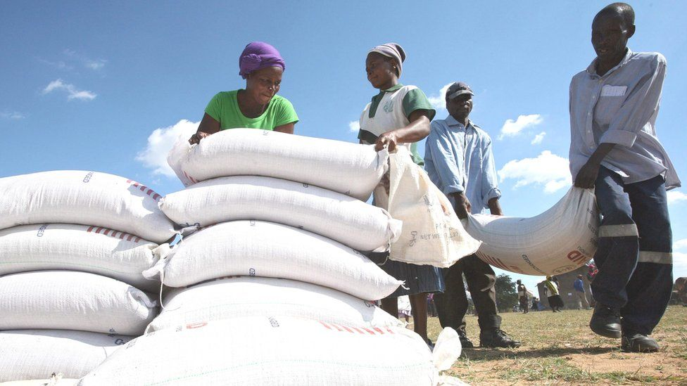 Zimbabweans receiving food aid