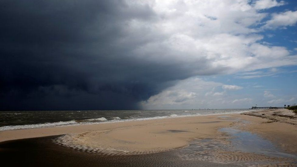 Storm clouds loom over a beach as Tropical Storm Gordon approaches Waveland, Mississippi. Photo: 4 September 2018