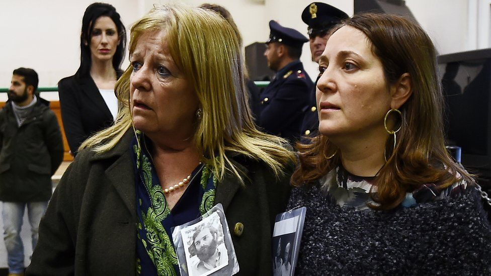 Relatives react to the sentence read by the judges of the Third Court of Rome during the trial of South American military officers and civilians accused of collaborating in the forced disappearances and murder of Italian nationals in Rome on January 17, 2017.