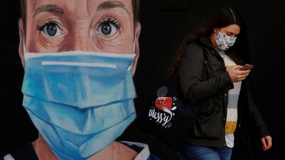 Woman wearing a mask in Manchester