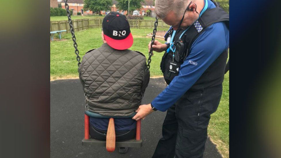PCSO with man stuck in swing