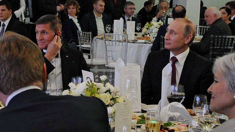 Gen Flynn (left) with President Putin, 10 Dec 15