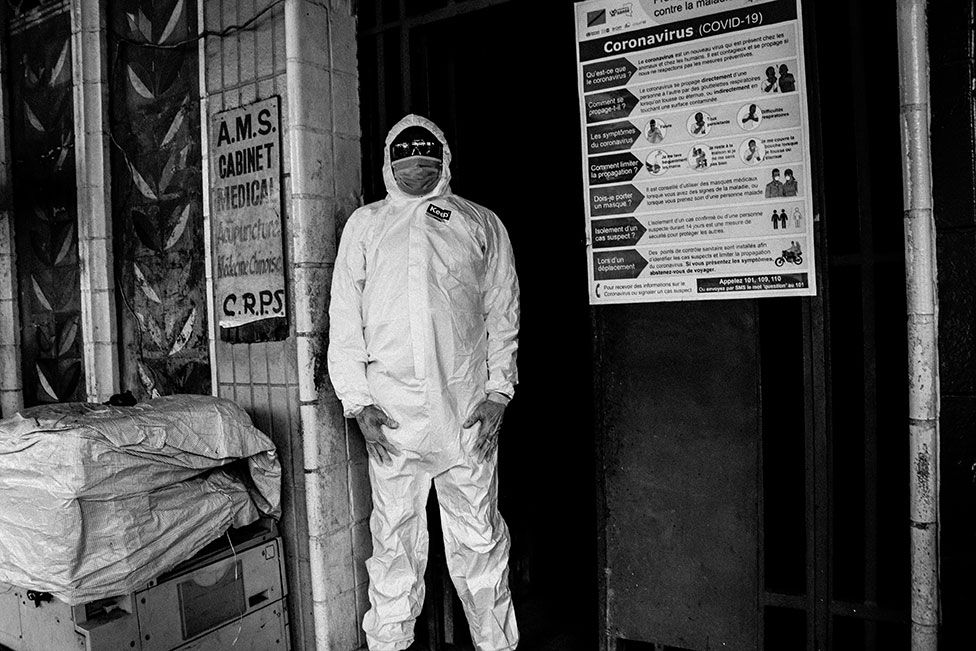 A person wears Covid-19 protective overalls and mask