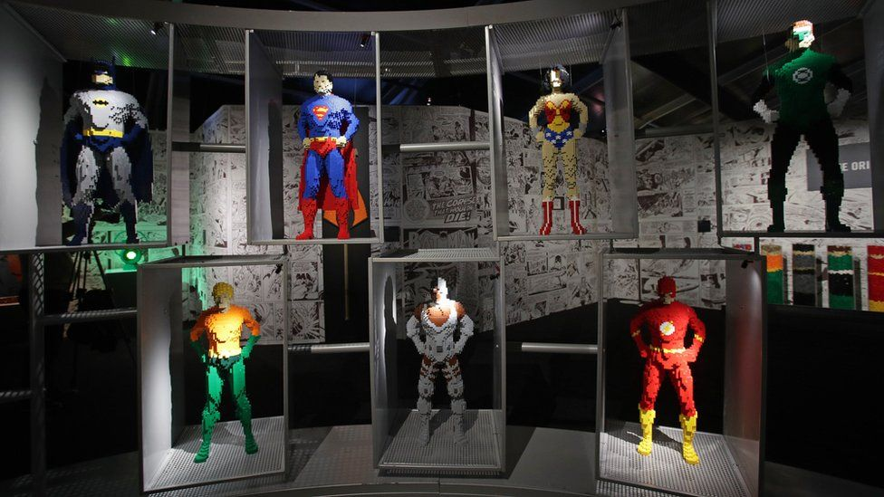 Models of various superheroes on display