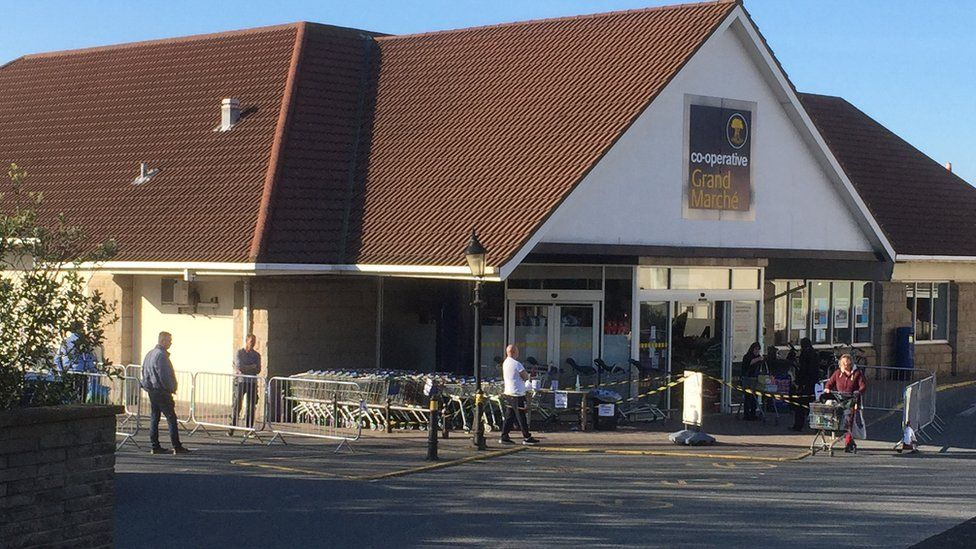 Shoppers social distancing outside a Guernsey supermarket
