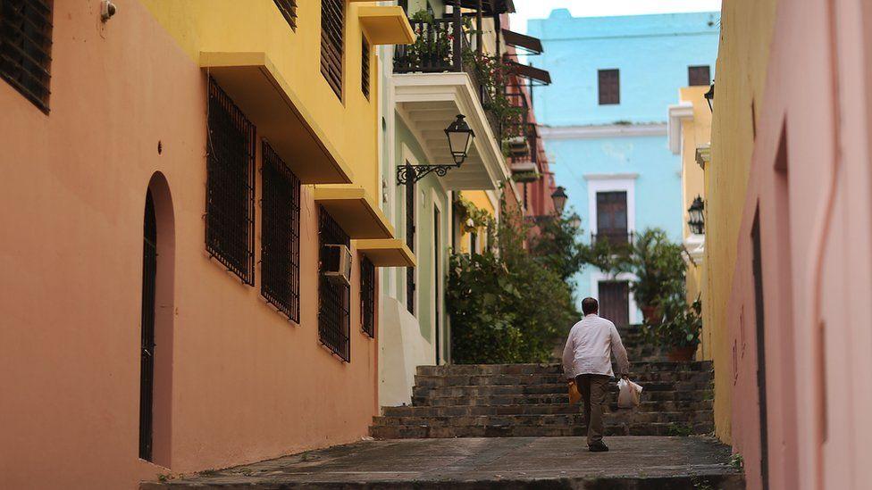Man walking up a sidewalk in Puerto Rico