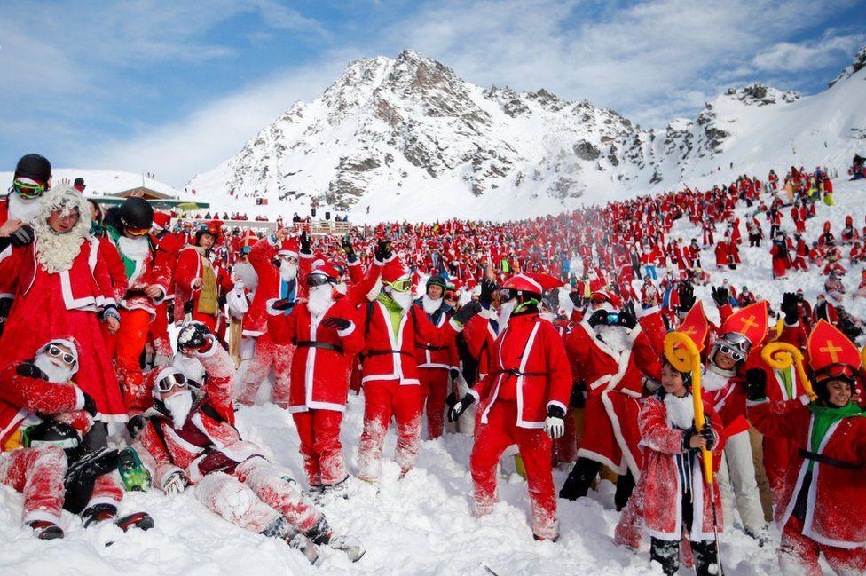 People dressed as Santa Claus