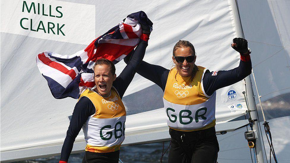 Team GB sailors Hannah Mills and Saskia Clark of Great Britain celebrate winning gold