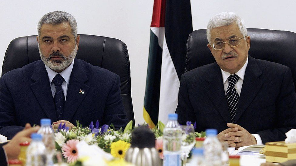 Palestinian Prime Minister Ismail Haniyeh and Palestinian President Mahmoud Abbas chair the first meeting of the new Palestinian unity government on 18 March 2007 in Gaza City