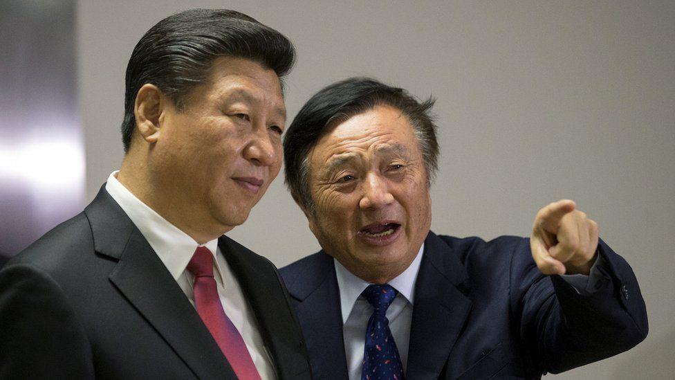 Chinese President Xi Jinping is shown around the offices of Huawei by Ren Zhengfei, president of Huawei, in London
