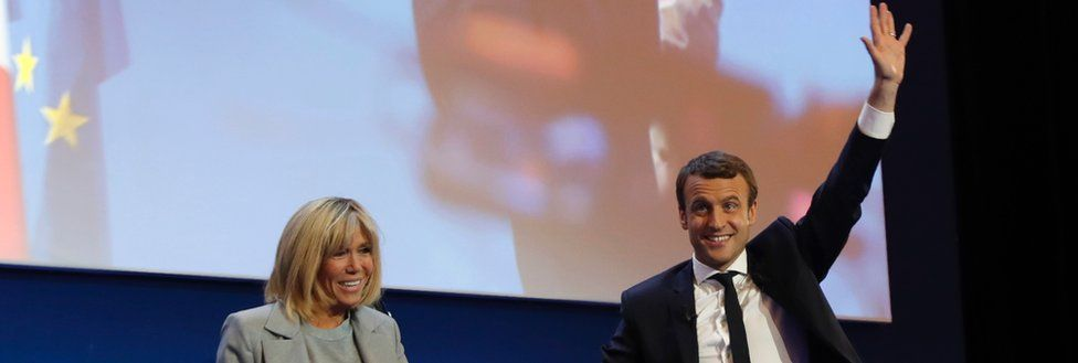 Emmanuel Macron, flanked by his wife Brigitte Trogneux, celebrates victory on 23 April