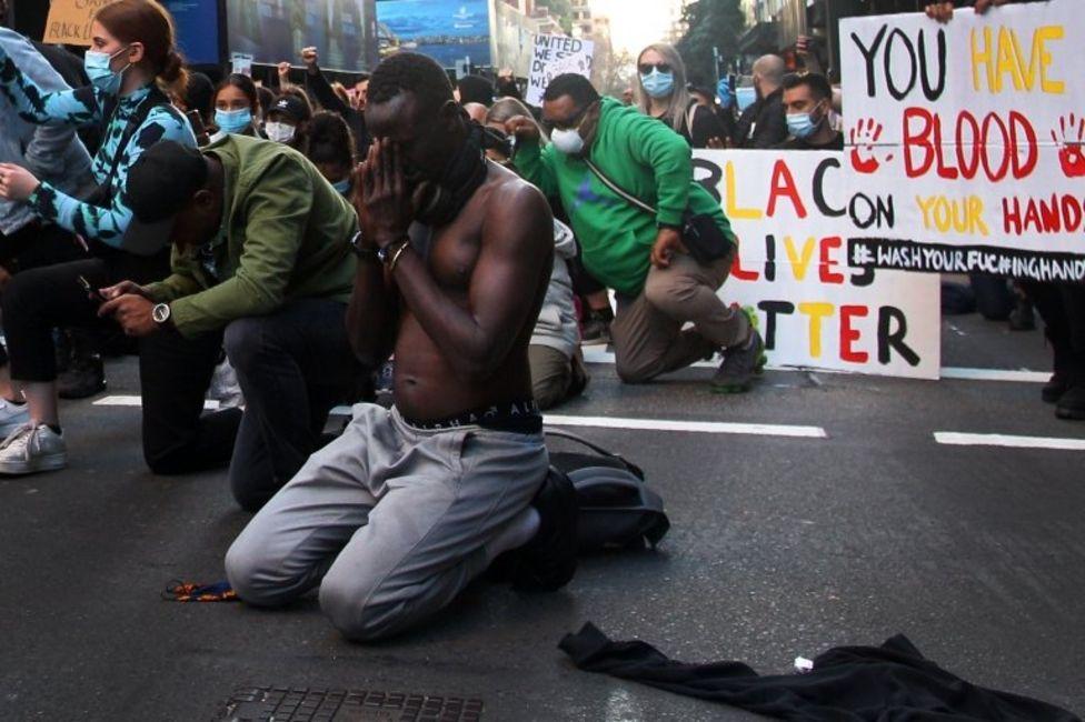 People kneeled in vigils in Sydney, Australia