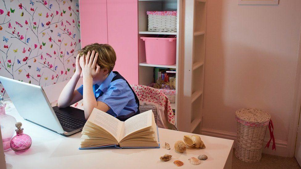 Sad child at a computer