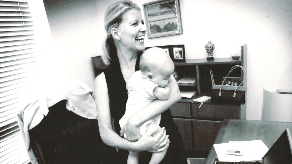 Natasha Stott Despoja holds her baby in her parliamentary office