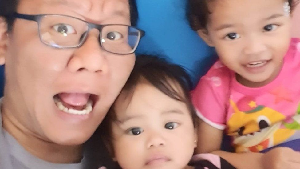 Muhammad Shalehan with his two daughters, aged two and three